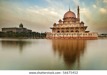 Putra Mosque is the principal mosque of Putrajaya, Malaysia. Building on the left is Perdana Putra which is Malaysian Prime Minister's office.
