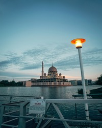 Putra mosque on dusk. View from Putrajaya lake