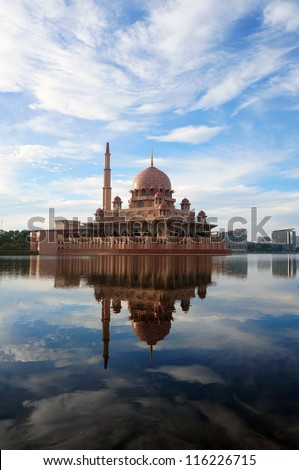 Putra Mosque (or masjid) at by the lake in Putrajaya, Malaysia.