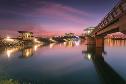 Putrajaya dam view during sunset with Putrajaya International Convention Center (PICC) as a background.