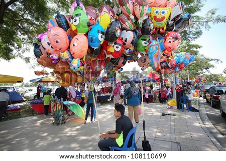 PUTRAJAYA - JULY 8: Balloons for sale at the Floral Festival on July 8, 2012 in Putrajaya, Malaysia. This flower themed event attracts thousands of visitors and exhibitors from all over the world. - stock photo