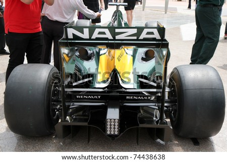 stock-photo-putrajaya-malaysia-april-rear-view-of-f-car-from-team-lotus-at-street-demonstration-april-74438638.jpg