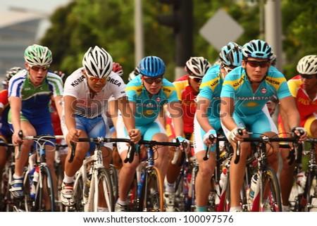 PUTRAJAYA, MALAYSIA - FEB 16 : The main cyclist peloton in 120km Road Race (Men Junior Category) during the 32nd Asian & 19th Junior Asian Cycling Championships on Feb 16, 2012 in Putrajaya,Malaysia
