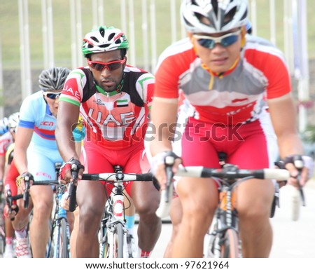 PUTRAJAYA, MALAYSIA - FEB 18: Unidentified cyclists from UAE compete during the Elite Men's Road Race (179.2km) at the 32nd Asian & 19th Junior Asian Cycling Championships on Feb 18, 2012 in Putrajaya, Malaysia.