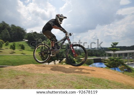 PUTRAJAYA, MALAYSIA - JANUARY 1: unidentified rider in a downhill mountain bike race during International Extreme Games 2012 in Putrajaya, Malaysia on January 1, 2012.