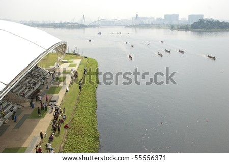 PUTRAJAYA, MALAYSIA - JUNE 19 : International participants row their boats during the 1Malaysia International Dragon Boat Festival 2010 (1MIDBF) JUNE 19, 2010 in Putrajaya Malaysia. - stock photo
