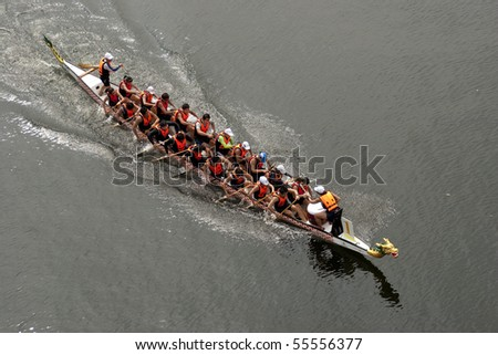 PUTRAJAYA, MALAYSIA - JUNE 19 : International participants row their boats during the 1Malaysia International Dragon Boat Festival 2010 (1MIDBF) JUNE 19, 2010 in Putrajaya Malaysia.