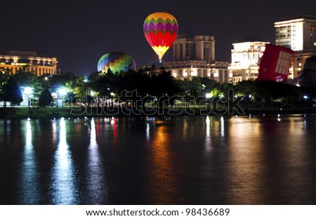 PUTRAJAYA, MALAYSIA-MAR 17: Raw view of hot air balloon in night session at the 4th Putrajaya International Hot Air Balloon Fiesta 17 Mar, 2012 in Putrajaya.