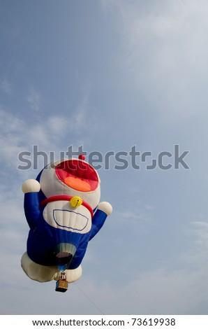 PUTRAJAYA, MALAYSIA - MARCH 18 : Doraemon hot air balloon flight at the Third Putrajaya International Hot Air Balloon Fiesta in Putrajaya, Malaysia on March 18, 2011.