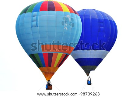 PUTRAJAYA, MALAYSIA-MARCH 23: Two hot air balloons alongside rides at the 3rd Putrajaya International Hot Air Balloon Fiesta Mar 23, 2011 in Putrajaya, Malaysia. More than 300,000 people visit this year event.