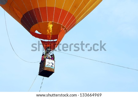 PUTRAJAYA, MALAYSIA - MARCH 29 : Unidentified visitors take the opportunity to fly with the balloon at 5th Putrajaya International Hot Air Balloon Fiesta on March 29, 2013 in Putrajaya, Malaysia.