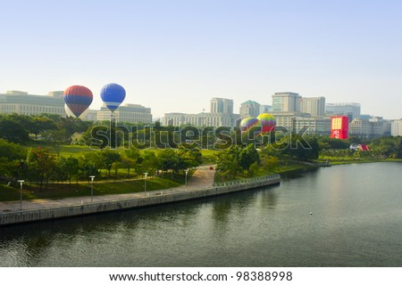 PUTRAJAYA, MALAYSIA-MARCH 18 :Variety of balloons take flight at the 4th Putrajaya International Hot Air Balloon Fiesta March 18, 2012 in Putrajaya.More than 300,000 people attended the event. - stock photo