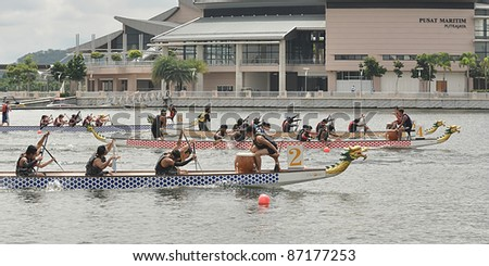 PUTRAJAYA, MALAYSIA - OCTOBER 22: Unidentified Dragon boat participants compete in  The 1st IDBF Cancer Survivors World Cup 2011 in Putrajaya, Malaysia on October 22, 2011.