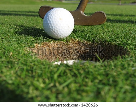 Putting a ball in the hole