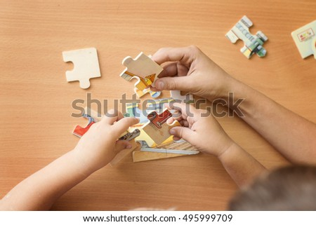putting a puzzle together #495999709
