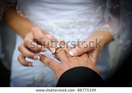 Putting a wedding ring on