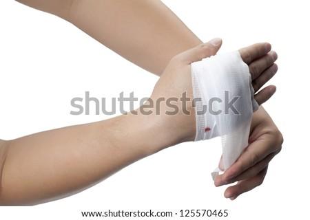 Putting bandage on an injured hand