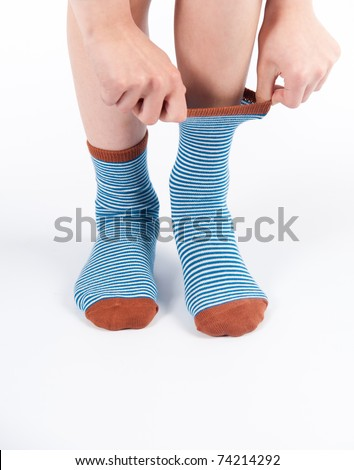 Putting Blue Striped Socks On