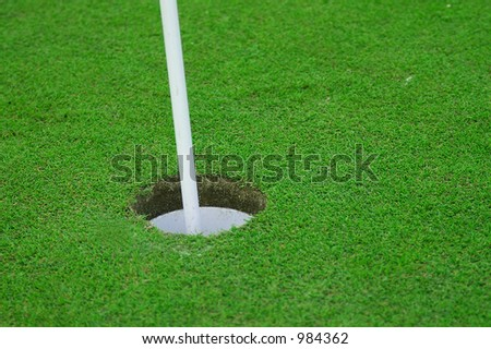 Putting green and hole