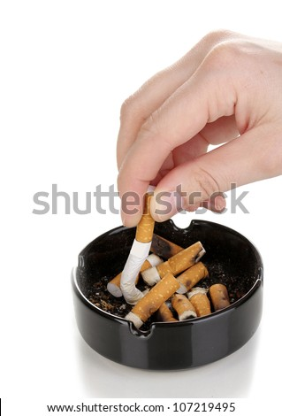 Putting out cigarette butt isolateed on white