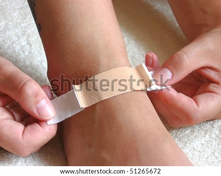 Putting plaster on foot