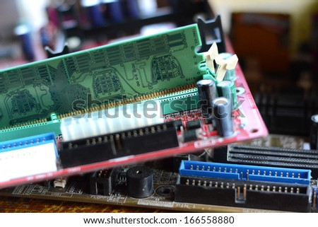 putting RAM into the memory slot on motherboard  #166558880