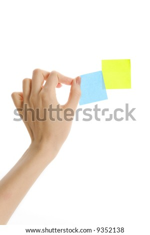 Putting sticky notes on the wall (isolated)