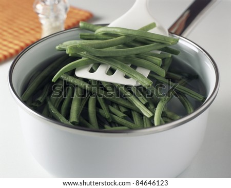 Putting the green beans in the boiling water