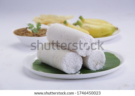PUTTU /WHITE RICE PUTTU -Kerala traditional  breakfast items made using rice flour which is very healthy and arranged in traditional way with white background