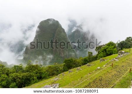 Putucusi (Phutuq K'Usi) mountain and Machu Picchu's citadel terraces, in Peru Stock fotó ©