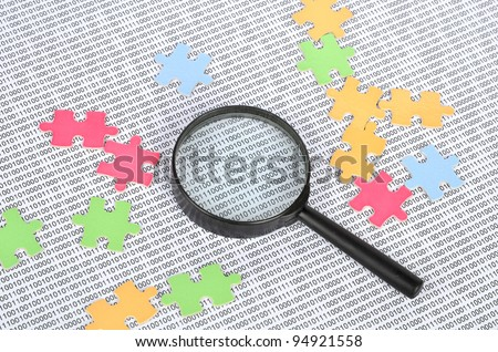 Puzzle and binary code with magnifier