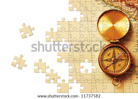 Puzzle Antique brass compass over old map background