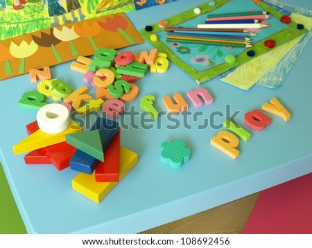 Puzzle, bricks, paintings and crayons for child