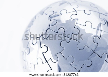 puzzle globe isolated over a white background