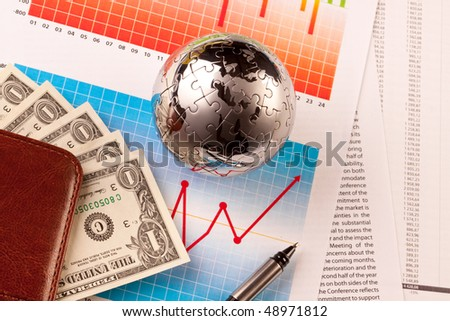 puzzle globe, money and world - international business concept