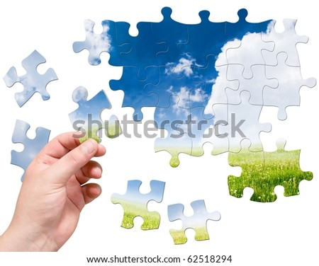 puzzle in hand on landscape background