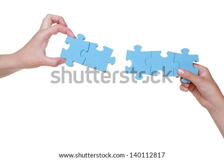 Puzzle in hands of mother and daughter