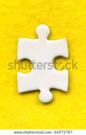 puzzle piece on a yellow background