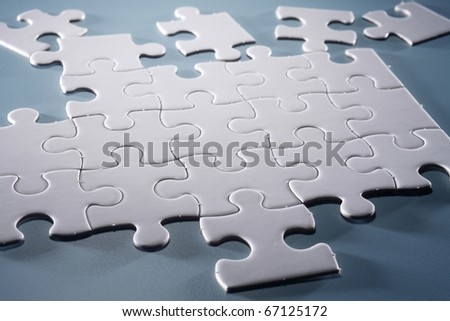 Puzzle pieces isolated on the blue background.