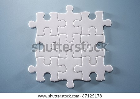 Puzzle pieces isolated on the blue background