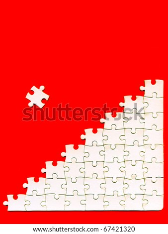 puzzle pieces on a red background
