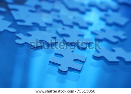 puzzle pieces on glass,  fluorescent mode selected for white balance