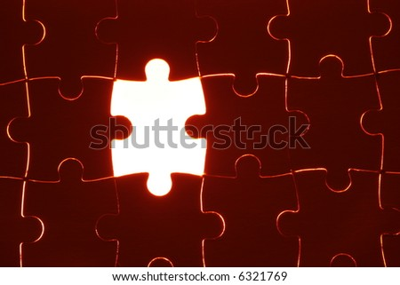 puzzle set with one piece of the puzzle missing - stock photo
