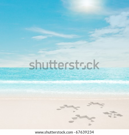 Puzzle traces on beach. 3d and photo montage