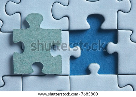 puzzle with a hole and the missing piece