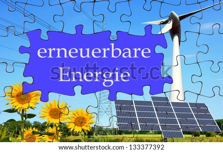 puzzle with sunflower, solar panel and wind mill with the german words renewable energy / renewable energy