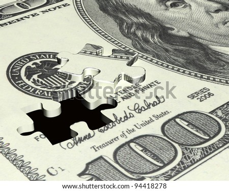 Puzzle with the image of dollar