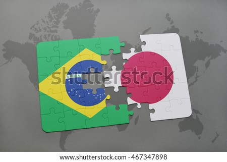 puzzle with the national flag of brazil and japan on a world map background. 3D illustration