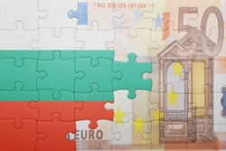 puzzle with the national flag of bulgaria and euro banknote . concept