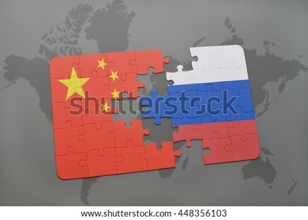 puzzle with the national flag of china and russia on a world map background. 3D illustration